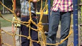 bosques : Boys Climbing Ropes at Playground