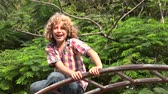 ginásio : Young Boy in Playground Stock Footage