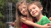 embraced : Adorable Toddler Siblings Hugging Stock Footage