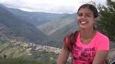 горная вершина : Smiling Female In Mountains Стоковые видеозаписи