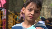 ginásio : Young Boy Eating At Playground Stock Footage