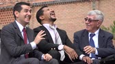 gag : Coworkers Or Business Men Laughing At Joke Stock Footage