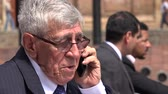 официальный : Confused Or Worried Ceo Or Senior Exec Talking On Phone