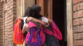 vasthouden : School Girls Hug Say Hello Stockvideo