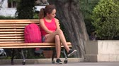 образование : College Female Student Sitting On Park Bench