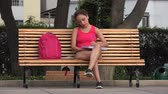 caderno : Female College Student Writing In Notebook Sitting On Park Bench