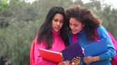 not defteri : Female Teen Students With Notebooks Stok Video