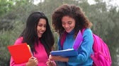 caderno : Happy Female Teen Students With Notebooks