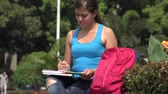 образование : Female College Student Reading Стоковые видеозаписи