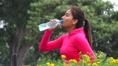 тонкий : Fit Female Teen Drinking Bottled Water