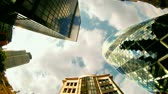business : fisheye shot looking up to the sky capturing the swiss RE (gherkin) building in london Stock Footage