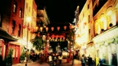 city lights : people rushing about in londons soho, chinatown at night
