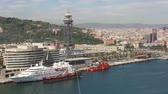 manzara : timelapse of the barcelona skyline shot from a high vantage point, focusing on the commercial and industrial port Stok Video