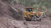 puerto vallarta : A jcb constructing a road in mexico Stock Footage