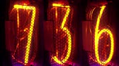 nixie : a numerical counter and number sequence filmed with an old nixie tube clock Stock Footage