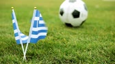 soccer background : Flag of Greece and football ball. Greek flag and ball on the grass.