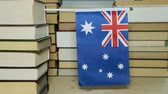 ausztrál : Australian flag and paper books, library. Flag of Australia on the background of books.