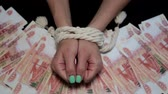Bound hands on the background of Russian rubles. Vídeos