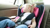 seat belts : child is traveling in the car. A small child is sleeping in a car seat.