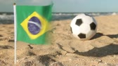 brasileiro : Sandy beach, football ball and the flag of Brazil.