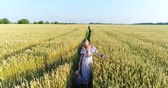 buğday : Aerial - Woman with baby and wheat field.