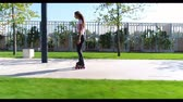 patenci : Woman roller skating in the park. Beautiful girl rollerblading. Stok Video