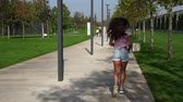 dürtmek : Beautiful woman running in the park. Fitness, slow motion. Stok Video