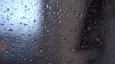 수분 : Autumn, rain drops flowing down the glass, close-up.