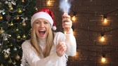 blasting : Christmas, a beautiful woman explodes a firecracker with confetti.