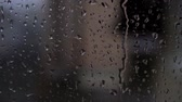 меланхолия : Autumn background, raindrops running down the window, slow motion.