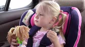 secuur : Baby girl rides in the car in a child car seat.