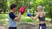 rękawice bokserskie : Female boxer training with coach. Womens boxing, sports, training. Wideo