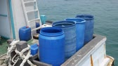 galon : Buckets for fresh water storage for use in fishing vessels at fishing pier of Chonburi Province, Thailand.