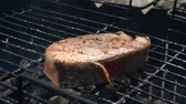 Salmon fish on a grill. Grilling salmon trout red fish steaks
