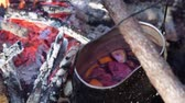 kardamon : Mulled wine in a pot over a campfire hike.