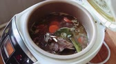 Meat with vegetables in the multicooker. Cooking time 動画素材