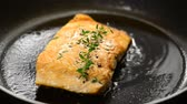 Fresh salmon steaks cooking for a healthy nutritious family meal