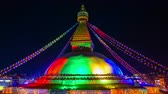 reconstrução : Time-lapse of the renovated Boudhanath stupa lit for its inauguration in Kathmandu, Nepal Stock Footage