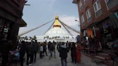 world heritage site : KATHMANDU, NEPAL - CIRCA FEBRUARY 2018: People walking around Boudhanath stupa. Boudhanath is a UNESCO World Heritage Site
