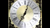 Clock face zoom running backward at speed ornate grandfather time travel
