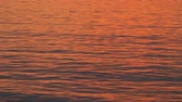 Wavy sunset water Stock Footage