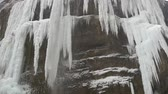 Cascade of waterfall in winter with icicles Stock Footage