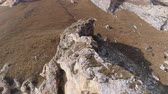 dolomiti : Man is walking along the crest of a cliff