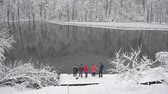 jinovatka : Group of tourists on the shore of a winter lake