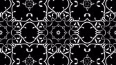 A black and white custom made floral design with kaleidoscopic effect. Seamless looping. Стоковые видеозаписи