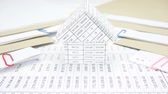 квитанция : House between stack paperwork report of sales and receipt with envelope place on table time lapse. House come in with document is increasing as work is going to be success. Business concept footage. Стоковые видеозаписи
