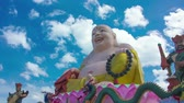 calm : HD Time Lapse Colorful Buddha image at day time with blue sky and white cloud moving
