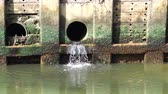 мутный : slow motion dirty water flow to sewer from city, waste water flows from a pipe, Sewage pipe polluting water