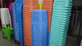 úsek : Stack of multicolored plastic seats, chairs for seating in rows in market