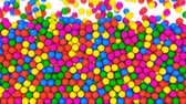 Pile of gumballs fill screen with colorful rolling and falling balls. Multicolored spheres in pool for children fun abstract transition. Bright 3D animation for composite overlay with alpha channel Stockvideo